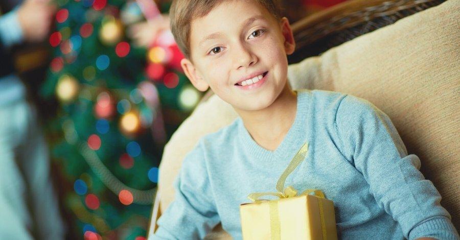 Tween Parent - Tween boy with gift