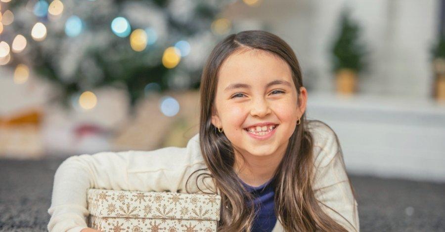 Tween Parent - Tween girl with gift