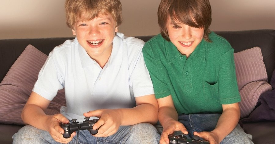 12 year old boys playing video game